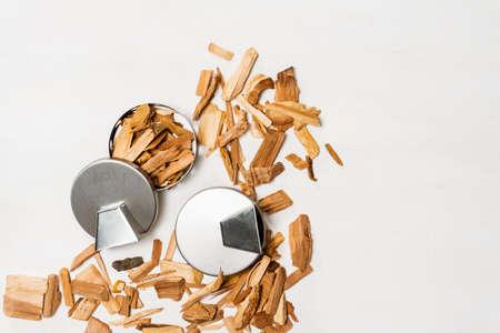 Stainless steel smoking pucks with smoking apple chips.
