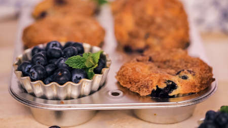 Out of the oven blueberry muffins with cinnamon and sugar topping. Stock Photo