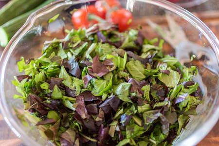 Preparing fresh salad with organic veggies.