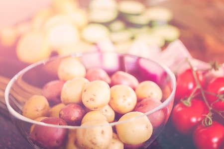 Slicing fresh organic vegetables for veggie kebabs.