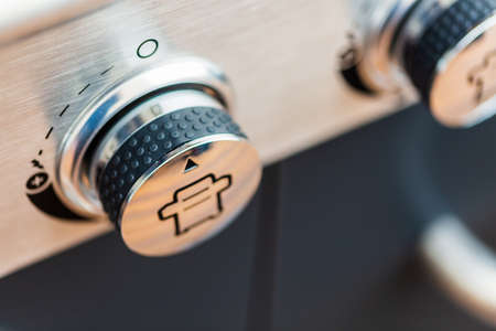 Close up of control knobs on outdoor 6 burner gas grill. 免版税图像