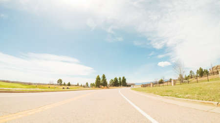 POV- Driving on paved road in suburban neighborhood in Colorado. Stock fotó