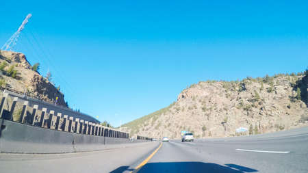 Driving on interstate highway I70 in the mountains.