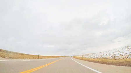 Driving on paved roads in rural suburbia. Stock Photo