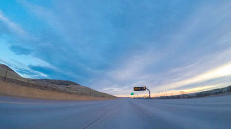 Driving on Interstate Highway I25 early in the morning.