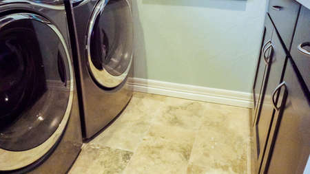 Modern laundry room in luxury house. Banco de Imagens