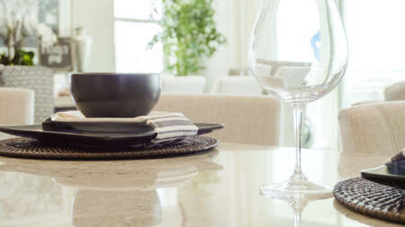 Modern dining room table in luxury house. Stock Photo