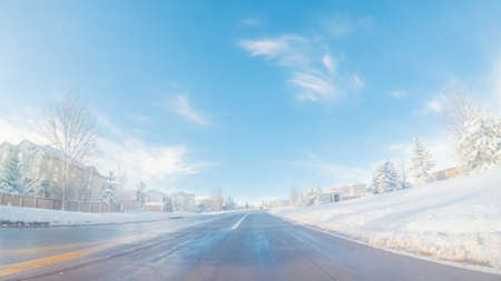 Driving on suburban road after Spring snow storm. 写真素材