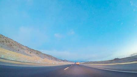 Driving on statehighway 470 at sunrise.