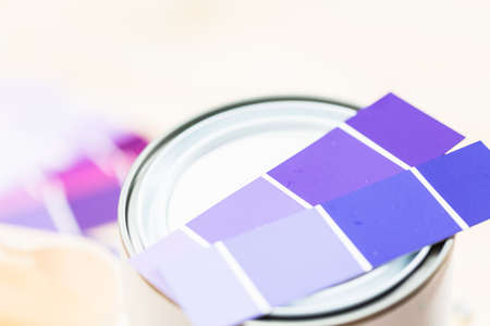 Paint swatches with purple paint sample and metal can with paint. Reklamní fotografie