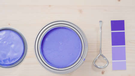 Opening metal paint can with purple interior paint.