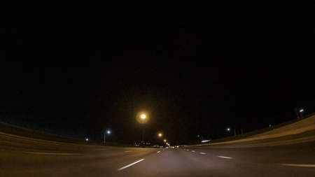 Driving on Interstate highway I25 at night.