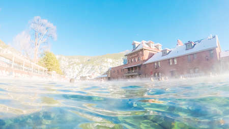 Swimming in outdoor hot springs pool in the Winter. Stock Photo