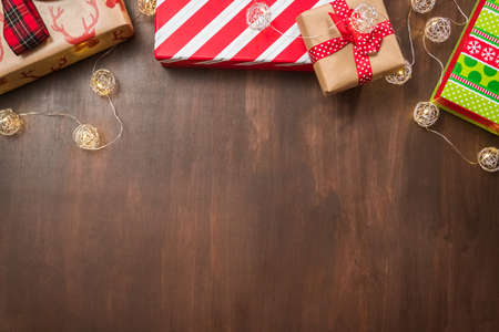 Christmas gift boxes on wooden table. Stock Photo