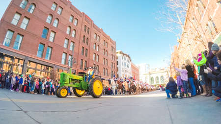 Denver, Colorado, USA-January 4, 2018-POV-The National Western Stock Show Kick-Off Parade with marching bands, floats, horseback riders, cowboys, cowgirls and  Longhorn cattle. Éditoriale