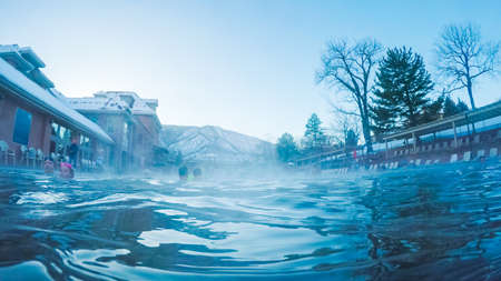 Colorado, USA-December 26, 2017. POV point of view - Swimming in outdoor hot springs pool in the Winter.