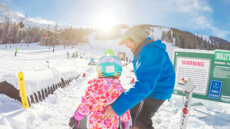 Colorado, USA-January 7, 2018-POV-Kids and adults learning to alpine skiing on bunny hill at Arapahoe Basin ski resort.