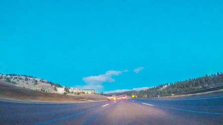 Denver, Colorado, USA-January 7, 2018-POV-Driving on Interstate highway I70 at sunrise.