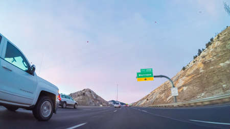 Denver, Colorado, USA-February 3, 2018-POV-Driving on Interstate highway I70 in the mountains at sunrise. Éditoriale