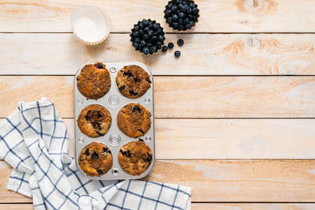Flat lay. Homemade blueberry muffins made with organic ingredients.