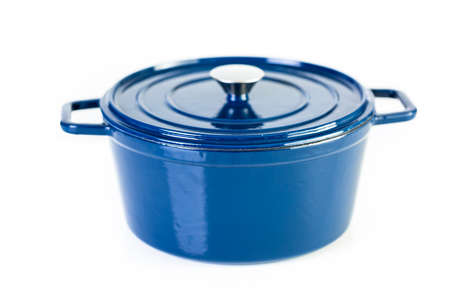 Blue enameled cast iron covered dutch oven on a white background.