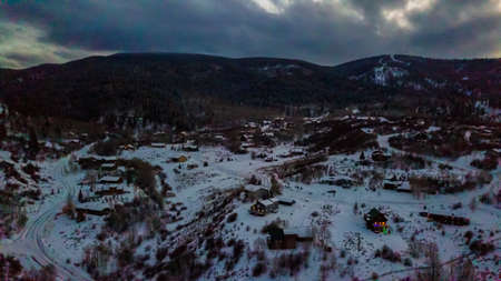 Aerial view of rural mountain community in the Winter.