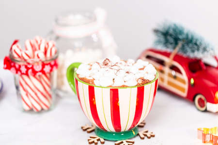 American hot chocolate with marshmallow toppings in large Christmas mug.