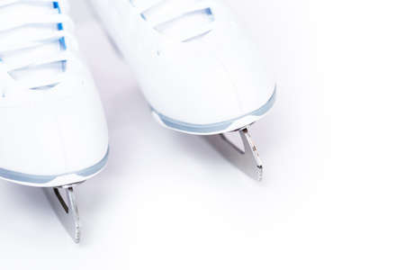 Close up view. New white figure skates on a white background.