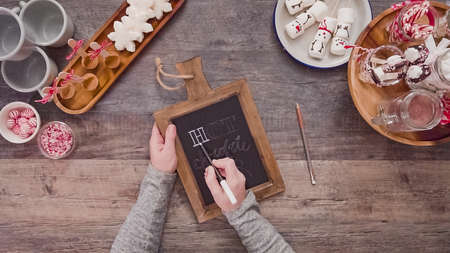 Step by step. Flat lay. Writing chalk board sign-Hot Chocolate Bar- for hot chocolate station.