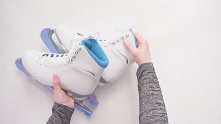 Flat lay. New figure skates on a white background.