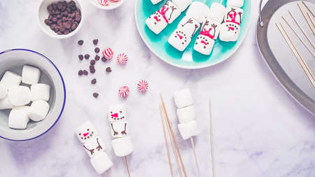 Step by step. Flat lay. Making marshmallow snowman and reindeer hot chocolate toppers for food gifting.