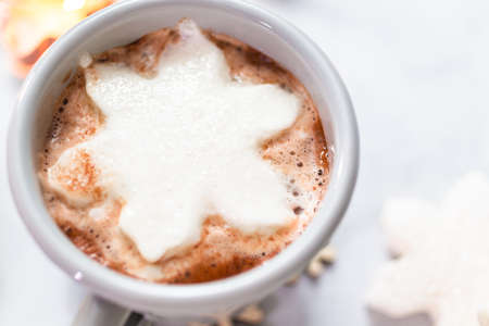 American hot chocolate with snow flake shaped marshmallow toppings. Stock Photo