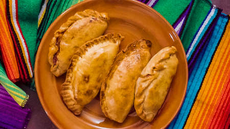 Flat lay. Homemade large empanadas with different staffings. Stock Photo