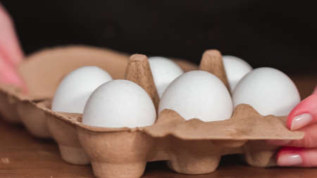 Step by step. Organic white eggs in egg crate.