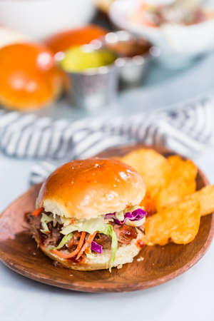 BBQ pulled pork sandwich in shape of small sliders with brioche buns. Stok Fotoğraf - 119298263