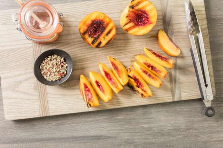 Grilled organic peachs for dessert.