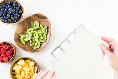 Ingredients for making fresh fruit popsicles with apple juice. 스톡 콘텐츠