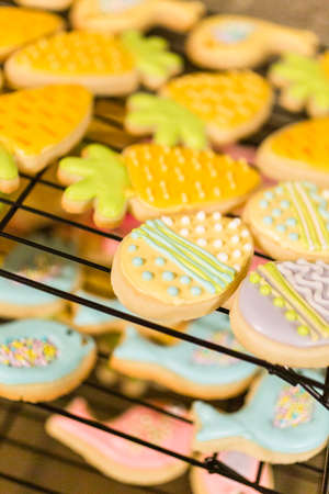 Easter sugar cookies decorated with royal icing of different colors.