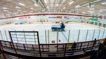Denver, Colorado, USA-December 16, 2018 - Zamboni machine cleaning the ice on indoor ice skating rink.
