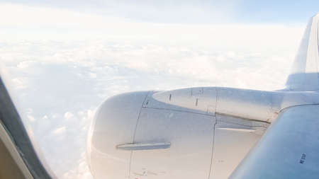 View from the window seat of commercial passenger airplane. Stock Photo