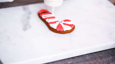 Step by step. Decorating gingerbread and sugar cookies with royal icing for Christmas. Stock Photo
