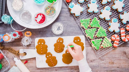 Flat lay. Step by step. Decorating gingerbread and sugar cookies with royal icing for Christmas.