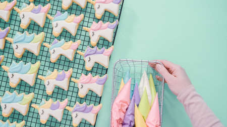 Unicorn sugar cookies decorated with royal icing and food glitter. Archivio Fotografico