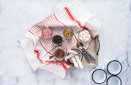Flat lay. Hot chocolate bar with variety of topping on the tray .
