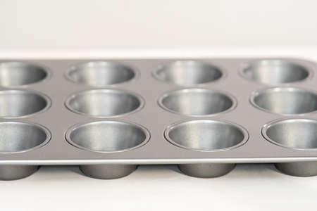 Empty metal cupcake pan on the table. Stok Fotoğraf