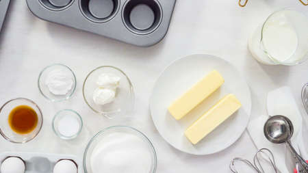 Flat lay. Step by step. Ingredient to bake vanilla cupcakes on the table. Stock Photo