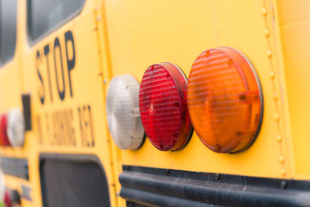 Close ups of yellow school bus on field trip.