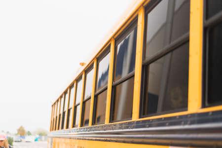 Close ups of yellow school bus on field trip.