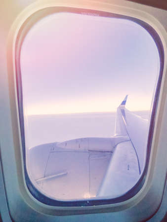View of the sunrise from the inside of passanger airplane. Stock Photo