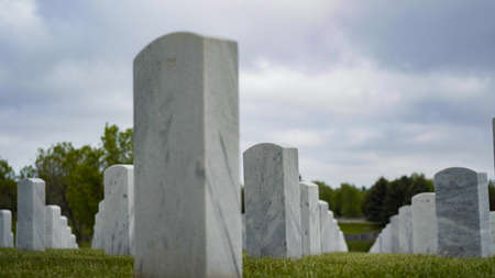 An endless rows of white marble gravestones at the Fort Logan National Cemetery on Memorial Day.